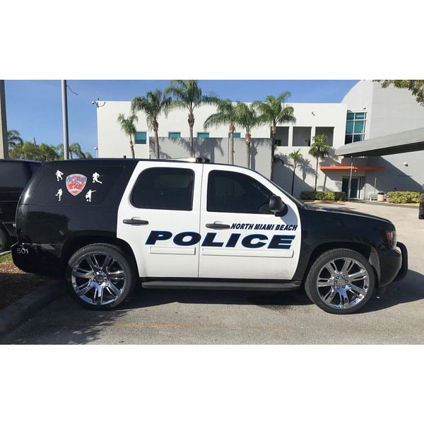 Set of CA88 chrome rims on a North Miami Beach Police Athletic League Chevy Tahoe